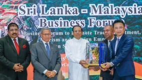 President heads business meeting in Malaysia