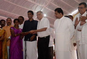 PM hands over title deeds for plantation community