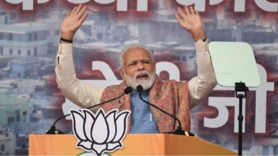 PM Modi defends citizenship bill amid clashes