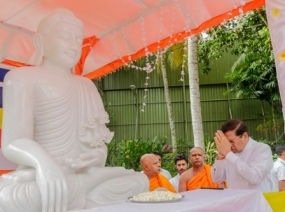 Floral tribute to Samadhi statue brought from Myanmar