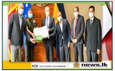 Head of NOCPCO Receives PPE & Gloves from Australian Department of Defence