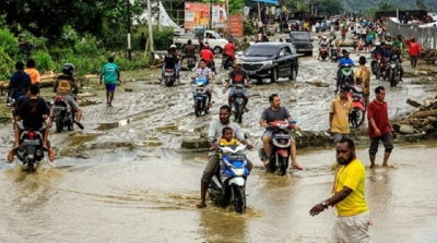Flash floods kill at least 50 in Indonesia