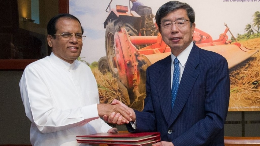 President  Visits ADB, signed three loan agreements totaling $455